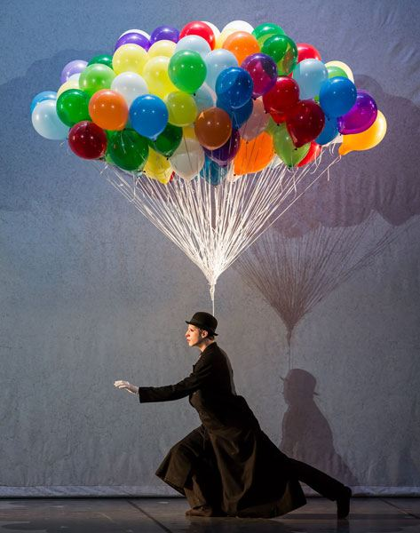 Sasha Riva, as The Balloon Man, a character at the carnival Playland, and a silent guide through the ballet.