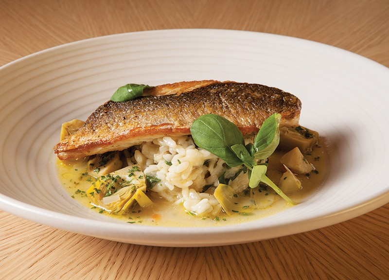 Pan-seared loup de mer with Swiss chard risotto and artichokes.
