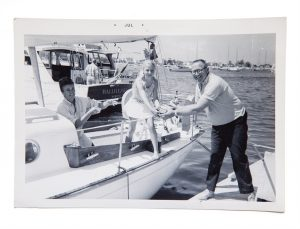 Molly with mom, Marilyn, and dad, Frank, loading the sailboat.