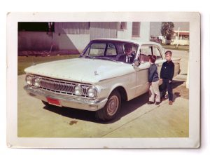 John, right, and younger brother Edward, next to dad Kent Moorlach's '62 Mercury Comet