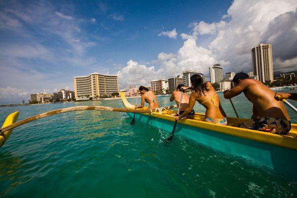Paddling a canoe off Waikiki beach