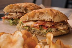 Stockyard Sandwich Company's smoked chicken club with Kewpie mayo on Bread Artisan Bakery slices.