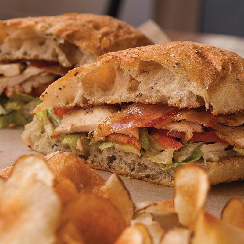 Stockyard Sandwich Company's smoked chicken club with Kewpie mayo on Bread Artisan Bakery slices.