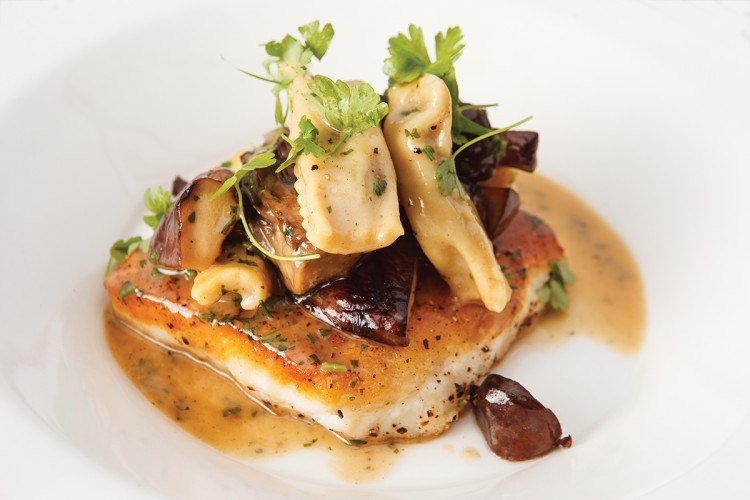"Local halibut with wild mushrooms and house-made ""burnt bread"" agnolotti."