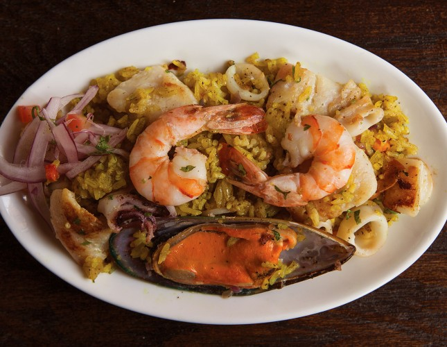 Peruvian-style seafood paella seasoned with dark beer