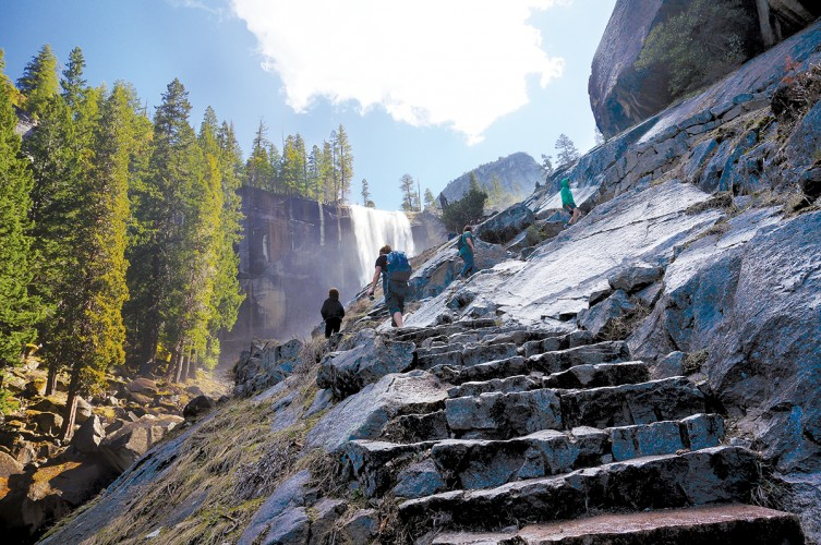 Hikers climb the Mist Trail Hike at Yosemite National Park.