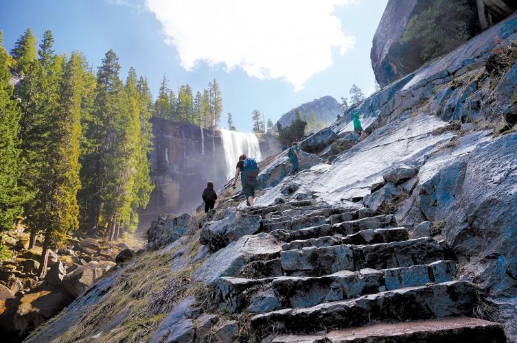 Hikers climb the Mist Trail Hike at Yosemite National Park.