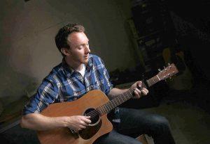 [Costa Mesa musician Dan Krikorian at his home on Thursday, July 28. Krikorian is a coach at Costa Mesa High School. (Scott Smeltzer)] *** []