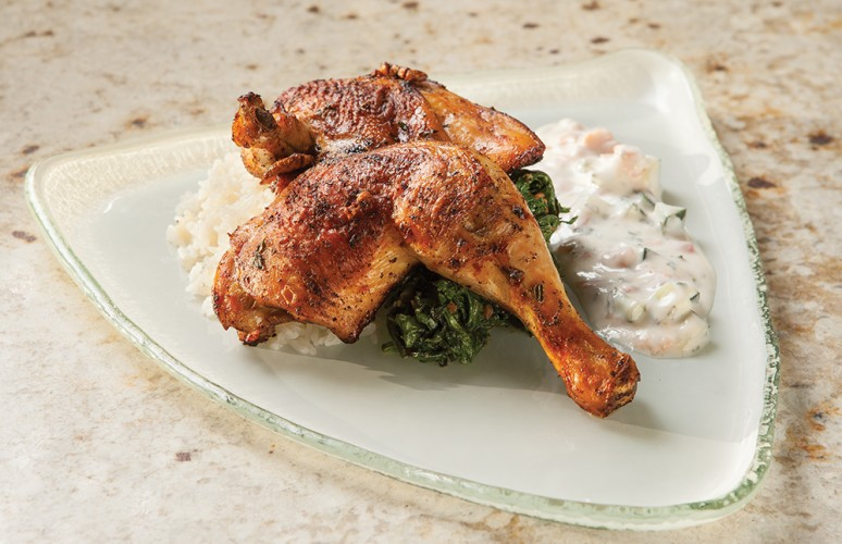 beer-brined Mary's Chicken with greens, buttered rice, and tomato raita.