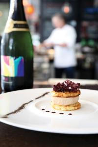 Foie gras mousse on brioche, below, is featured at Christopher's and Crush Lounge
